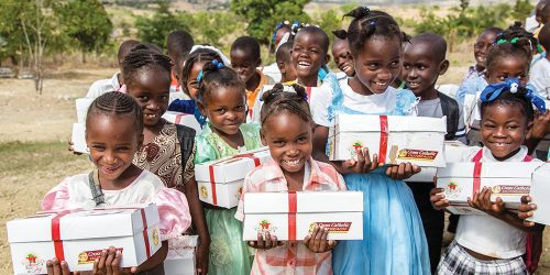 Children in Haiti recieve gifts at a Box of Joy distribution