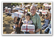 Jim Cavnar distributing Boxes of Joy