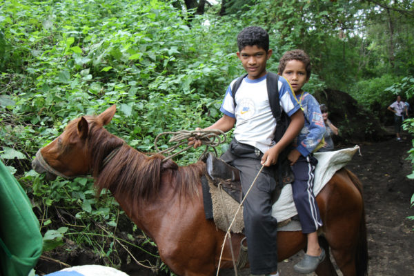 In rural villages in Nicaragua, children like these often travel on horseback to fetch water from remote wells and streams.