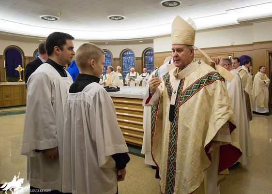 "For Brett Haubrich, ""Priest for a day"" activities was arranged by Cross Catholic board member, Archbishop Robert J. Carlson."