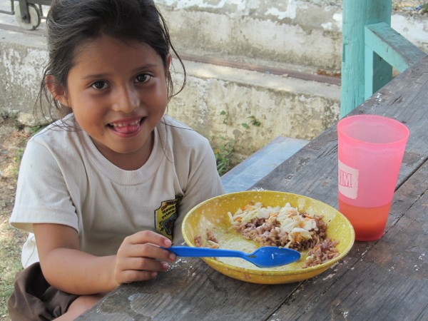 A student enjoying her lunch at Mount Carmel Primary School in Benque Viejo, Belize. Support from Cross Catholic Outreach ensures that economically-disadvantaged children at the school are fed a nutritious daily meal, so they'll have sharp minds and healthy bodies.