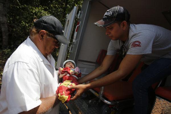 Carlos & Jose rescuing child in Guatemala