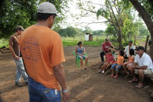 Amigos for Christ members speak at a community meeting in a remote Nicaraguan village.