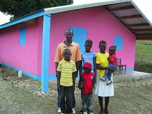 Caroline is raising money so a poor family like this one can live in a safe and sturdy home.
