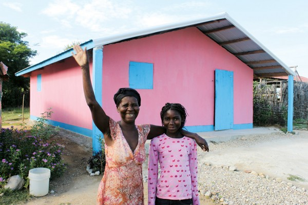 """When I lived in the old house, I was living in difficulty. The old house had leaking, a wet floor, and every year we'd have to put on new mud. The new house is a blessing from God. Now in the new house, I'm living in paradise."" – Acephie Bernard, a recipient of a Cross Catholic funded house through our ministry partner, the Haiti Kobonol Mission. Acephie says she raises her hand in thanks to God for the house he has provided her with."
