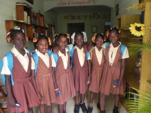 The girls of Bethsaide ready for a day at school. (Iverose is pictured fourth from left with the white ribbons)