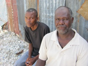 Joseph Dasseus, right, and his son, Joseph Jean Bernard, has relied on faith to get him through the many challenges Haiti has faced in 2010.