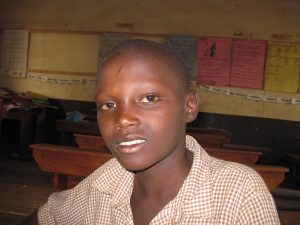 Gerald is finally getting an education, thanks to Cross Catholic-funded St. Francis Family Helper.