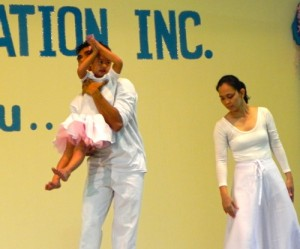 The handicapped Filipino girl glowed as she was brought out on stage in a little white dress and pink bow.