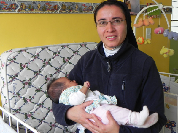 This is Sister Mayra Lopez. She's the director of St. Vincent de Paul Orphanage in Quito, Ecuador. The precious baby in her arms is Estefania. She was brought to the orphanage one icy-cold night after being found abandoned in a public park at one o'clock in the morning. Today, thankfully, she's well, warm and loved.