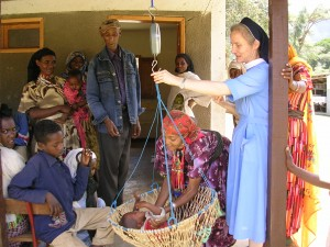 Sr. Anna Trzepacz of the Medical Missionaries of Mary provides life-saving care to remote mountain villagers in Minne, Ethiopia. Here she checks a child's weight during an annual physical.