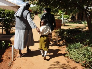 After surgery for her bowed legs, Grace is now able to walk with little effort