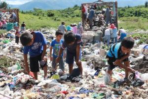 Children foraging through trash in Guatemala
