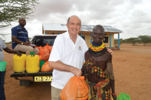 Jim Cavnar helping distribute food in Kenya