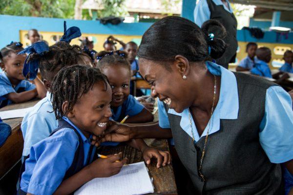 Kobonal Mission school in Haiti.Teacher Guillaume Camineta