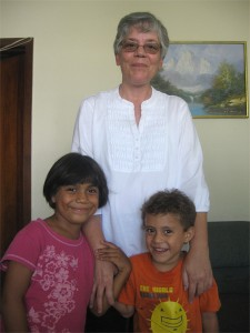 Javier, now 6, (right) with his newly-adopted family, Ana and sister, Francis.