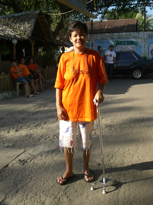 Dolores Rodriguez leans on the cane Sr. Liane provided to help her walk after she had a stroke while in prison.