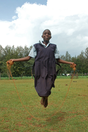 One of the girls at St. John Bosco enjoys a little jump rope after school.