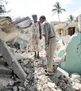 Jim Cavnar, president of Cross International Catholic Outreach, surveys the damage in Leogane where nearly all of the houses were destroyed by the quake. Cross Catholic is supporting an IDP camp of about 200 people who lost their homes there.