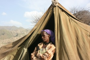 Before she was provided a sturdy home through Cross Catholic, Tesfesseha and her children weathered the cold nights in this makeshift tent.
