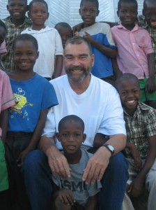 Fr. Marc (center) has been rescuing orphaned and destitute children in Haiti for more than a decade.