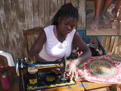 Zeinabo uses her feet to power her manual sewing machine and, in essence, her business.
