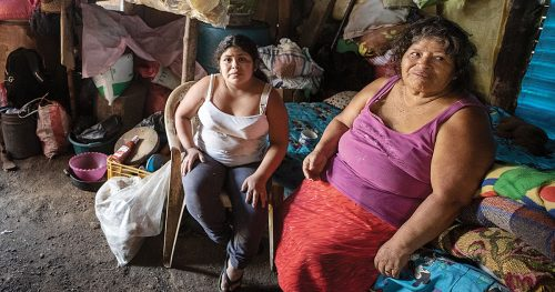 Mother and daughter in dwelling in need of replacement