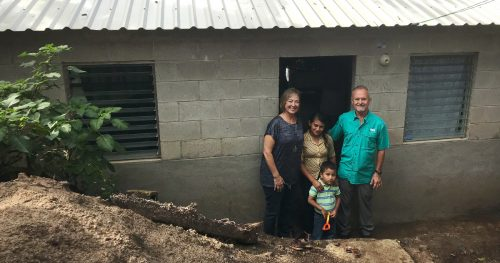 Terry and Cindi Ruder standing in front of newly constructed home in Santa Rosa, Guatemala