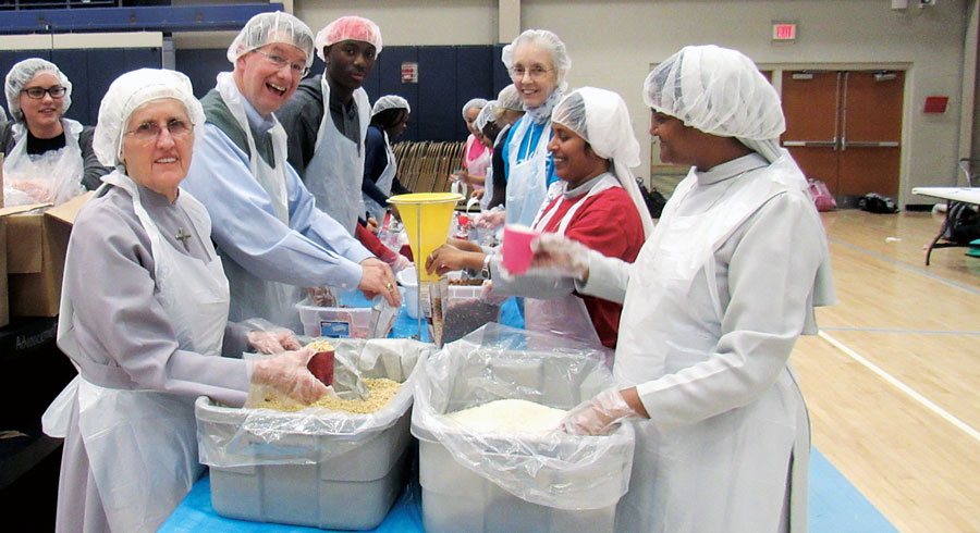 volunteers at a food packing event