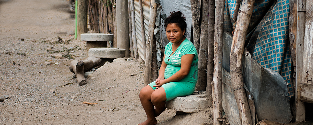 Young Guatemala woman sitting on a bench