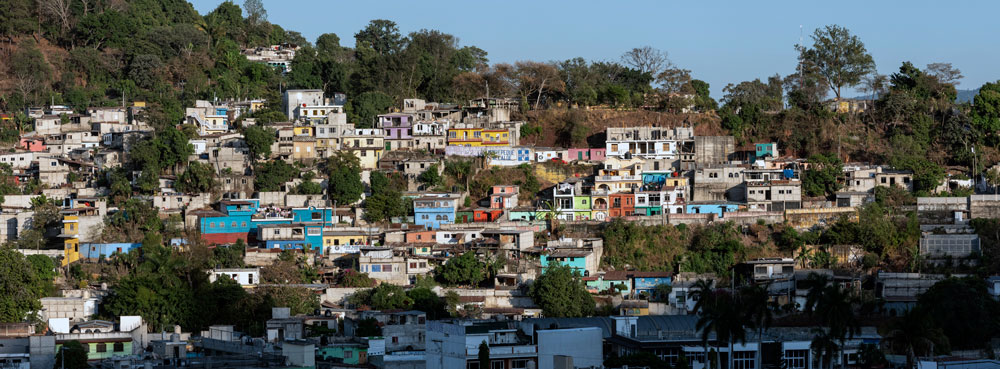 Shanties dot a mountainside.