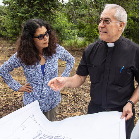 Fr. Raúl working on housing project floor plan
