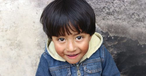 A smiling child in Ecuador