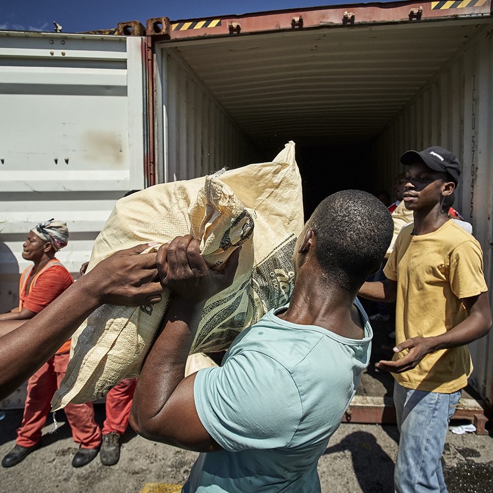 Unloading a container loaded with disaster relief supplies
