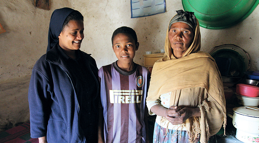 An Ethiopian nun visits a family
