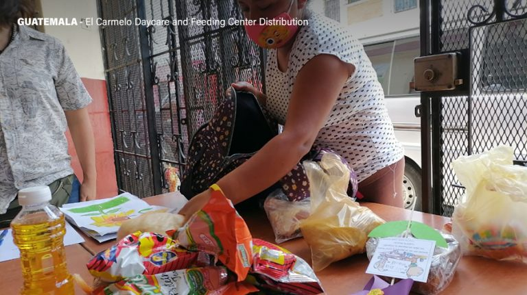 A worker at El Carmelo Daycare and Feeding Center prepares baskets of food for distribution to Guatemala's poor