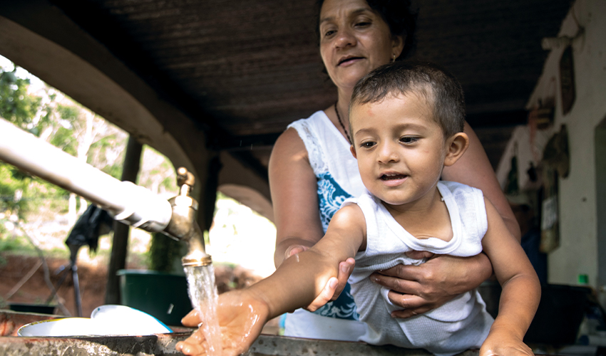 Mayra Ramirez and her son enjoying the blessing of having clean water at home
