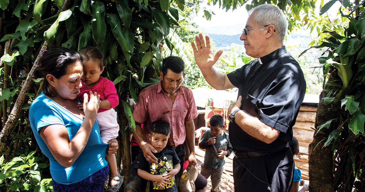Father Raul blesses a family in the Diocese of Santa Rosa de Lima in Guatemala