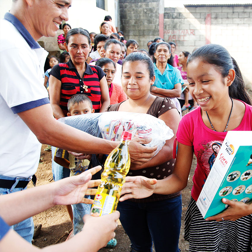 A girl in rural Guatemala receives essential cooking supplies through a food distribution program