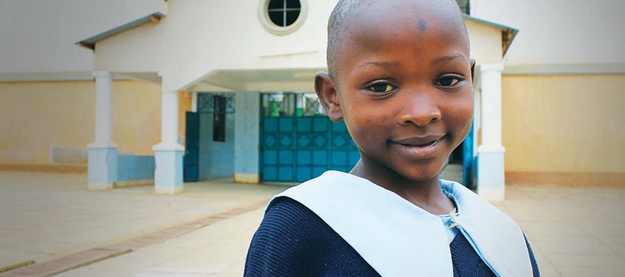 A smiling child at St. Frances and St. Clare Homes in Meru, Kenya