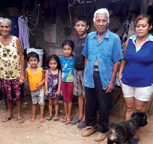 Marta Luz (left), pictured with four of her grandchildren, her brother and her daughter outside their home.