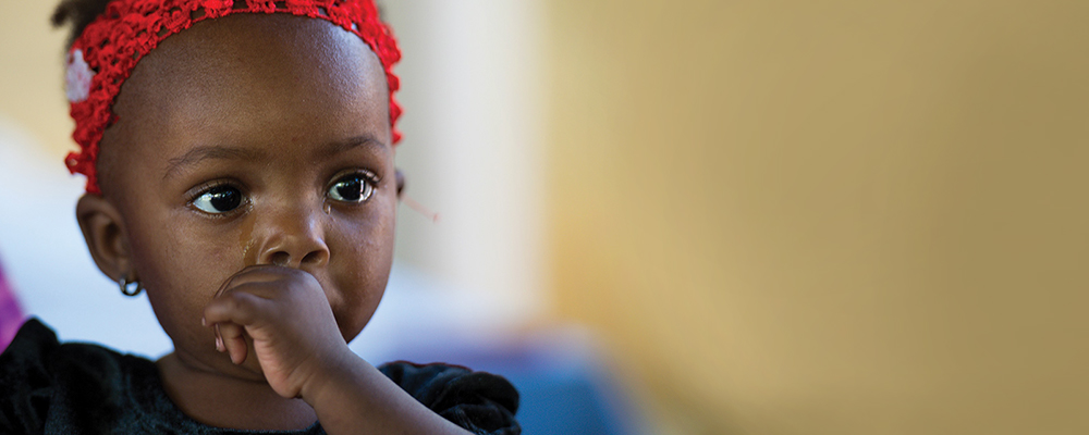 Leika, 9 months old, has only known a life of extreme poverty in Ouanaminthe, Haiti, and is at risk of malnutrition.