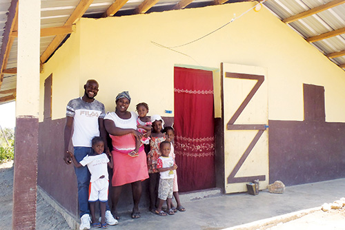 After: The Phanel family are all smiles in front of their new home.