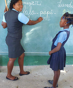 Anise's joy is evident as she teaches her students at Kobonal Mission School.
