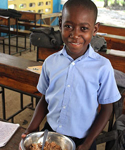 Loubens receives nutritious lunches every day at Kobonal Mission School.