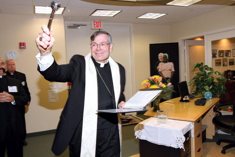 Bishop Barbarito of Palm Beach blesses the Cross Catholic Outreach offices.
