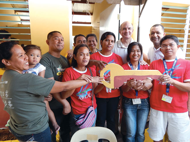 Jim visits with families receiving new homes through Answering the Cry of the Poor, the humanitarian arm of Couples for Christ. Since 2006, Cross Catholic Outreach has helped build hundreds of houses for families served by Couples for Christ.