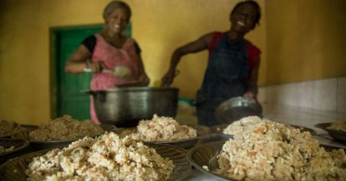 Women prepare Vitafood for the elderly at an assisted living home in Haiti.