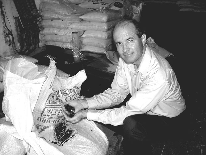 In 2001, Jim visits a Miami warehouse where Cross Catholic Outreach's first shipments to Haiti are being prepared.