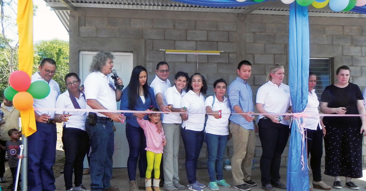 Dedication ceremony for house construction project.